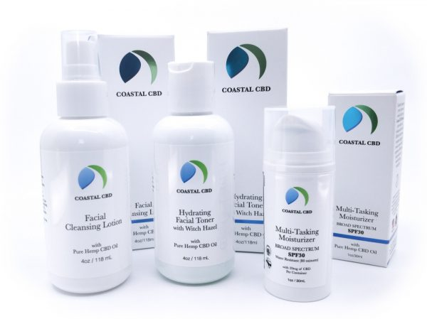 Daily Essentials CBD Skincare Gift Set: 3 bottles and boxes showing Facial Cleansing Lotion, Hydrating Facial Toner and the Multi-Tasking Moisturizer SPF30 by New Coastal | newcoastal.shop